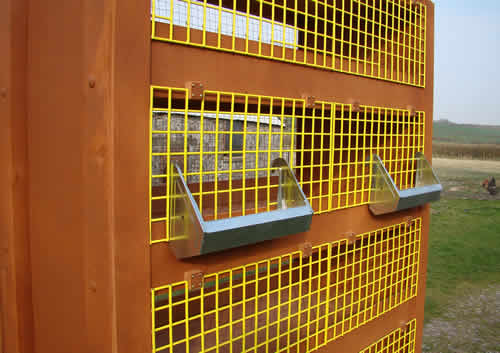 Quail cage with external feeder and drinker fitted
